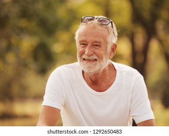 Portrait Happy old man in park retirement concept