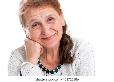 Portrait of a happy old woman on a white background