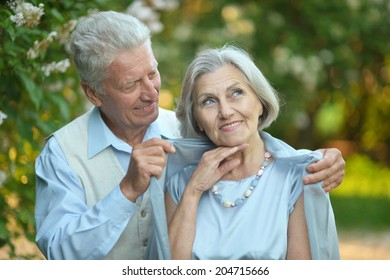 Portrait of a happy older couple on a walk in the park