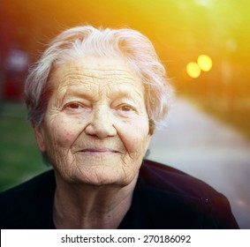 Portrait of happy older lady outdoors