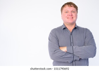 Portrait of happy overweight businessman smiling with arms crossed