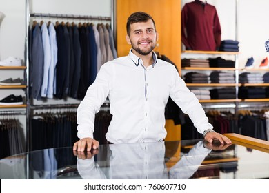 Portrait of happy owner male in men shop