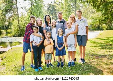 Portrait of happy parents embracing children
