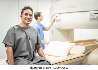 Portrait of happy patient looking at camera before MRI in hospital lab. Middle aged man smiling in clinic before medical treatment. Latino people and health care. Copyspace included