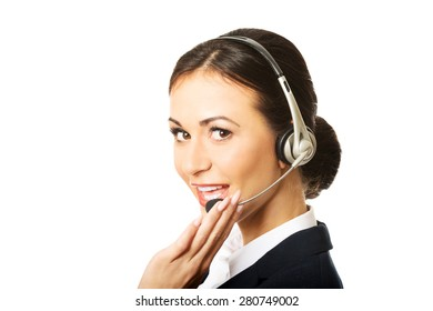 Portrait of happy phone operator in headset.