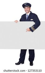 Portrait Of Happy Pilot Holding Blank Placard On White Background