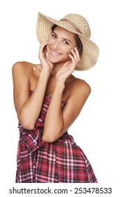 Portrait of happy playful woman in country style isolated on white  backgorund.  Smiling woman wearing chequered summer dress and broad-brim straw hat