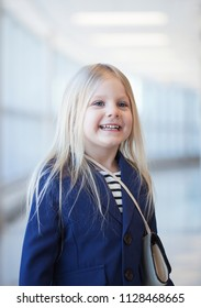 Portrait of happy preschool little girl wearing blue jacket