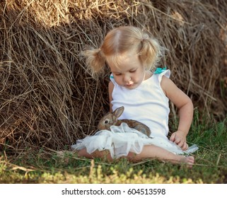 Portrait of happy pretty girl with rabbit. outdoor, Easter