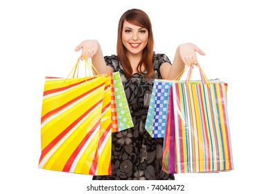 portrait of happy pretty woman with bright shopping bags