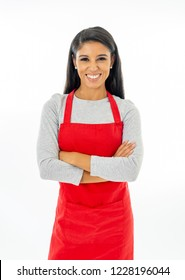 Portrait of a happy proud beautiful latin woman wearing a red apron learning to cook making thumb up gesture in cooking classes small business and homemade spanish food concept isolated on white