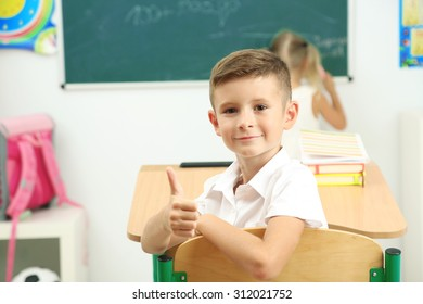 Portrait of happy pupil at lesson