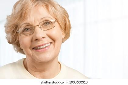 Portrait of happy retired senior woman wearing new eyeglasses.