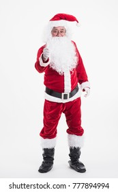 Portrait of a happy Santa cross showing thumb up on a white background, Winter holiday, Merry Christmas and happy new year concept