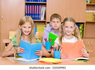 Portrait of happy school children with books