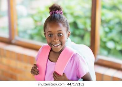 Portrait of happy schoolgirl smiling at school