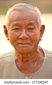 Portrait Of Happy Senior Asian Man At Outdoor