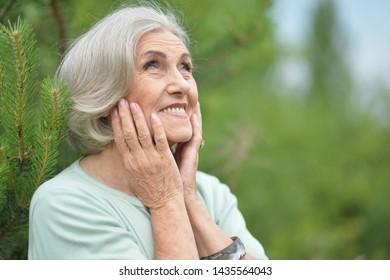 Portrait of happy senior beautiful woman in spring park