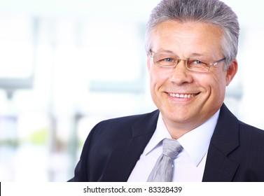 Portrait of a happy senior business man smiling