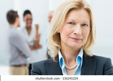 Portrait Of Happy Senior Businesswoman In Office