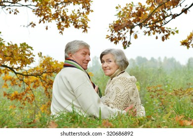 Portrait of a happy senior couple in autumn park