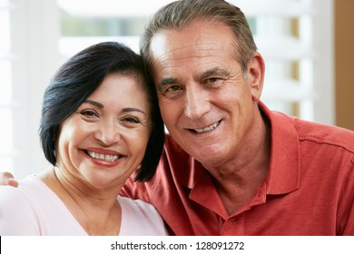 Portrait Of Happy Senior Couple At Home