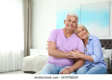 Portrait of happy senior couple at home. Space for text