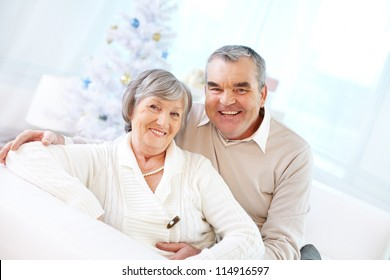 Portrait of a happy senior couple looking at camera and smiling