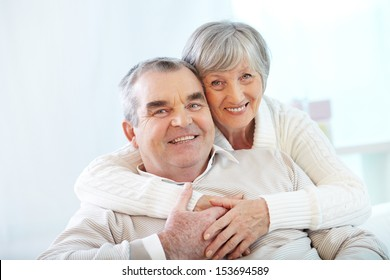 Portrait of a happy senior couple looking at camera