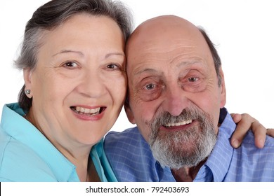 Portrait of happy senior couple looking at camera. Isolated white background