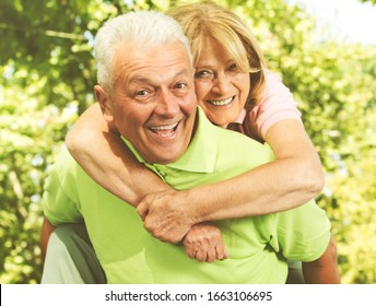 Portrait of happy senior couple in love , elderly woman and man in the park.