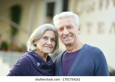 Portrait of happy senior couple posing in park