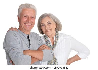 Portrait of happy senior couple posing isolated on white background