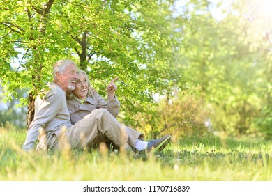 Portrait of a happy senior couple sitting outdoors