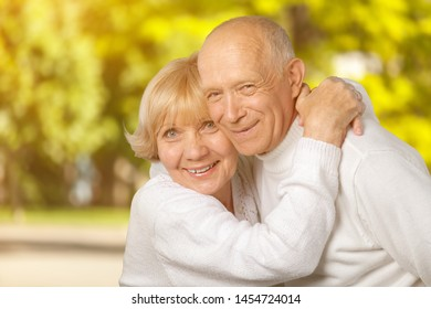 Portrait of happy senior couple smiling at home