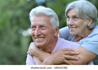 Portrait of a happy senior couple in summer outside