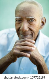 Portrait of happy senior hispanic man looking at camera and smiling