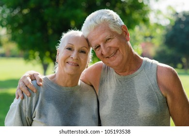 Portrait of happy senior husband and wife after fitness in city park