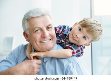 Portrait of happy senior man with grandson