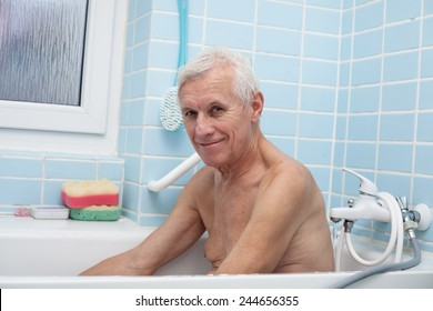 Portrait of happy senior man sitting in bath.