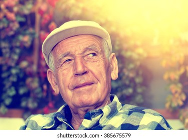 Portrait of  happy senior man smiling and thinking about something nice