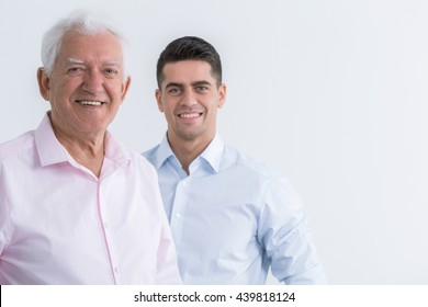 Portrait of happy senior man and smiling young man