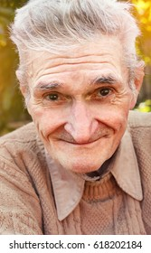 Portrait of happy senior man smiling