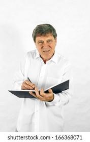 Portrait of a happy senior man standing gesturing against white background