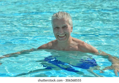 Portrait of a happy senior man in swimming pool