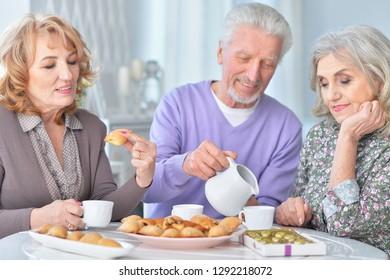 Portrait of happy Senior people drinking tea