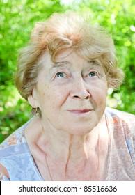 portrait of a happy senior woman in the garden