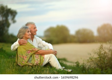 Portrait of happy senior woman and man in park