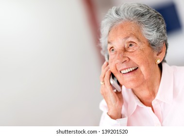 Portrait of a happy senior woman on the phone