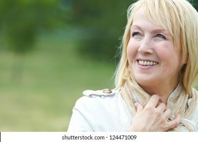 Portrait of happy senior woman in park